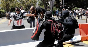 Demonstrator Joey Gibson, second from left, is chased by anti-fascists during a rally Sunday in Berkeley, California. (AP photo: Marcio Jose Sanchez)
