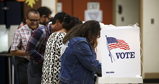 Voters cast ballots Nov. 8, 2016, at the Brooklyn Avenue Elementary School in Los Angeles, California. (Bloomberg News photo)