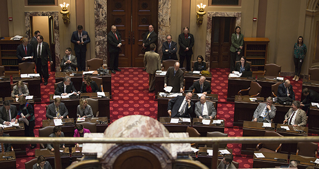 Senate Majority Leader Paul Gazelka, R-Nisswa (standing at his desk, second row from the rear), rises to address his colleagues during the April 9 floor session. Gazelka says he is frustrated that another lawsuit has been filed by a constituent against Sen./Lt. Gov. Michelle Fischbach, R-Paynesville. (Staff photo: Kevin Featherly)