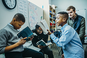 Young scholars at the Prodeo Academy read together in a study group. (Submitted photo: Prodeo Academy)