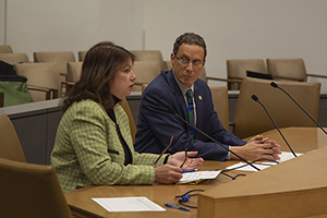 Julie Jonas, legal director for the Innocence Project of Minnesota, testifies for a bill from Sen. Ron Latz, DFL-St. Louis Park (right), which redefines what an exonerated person is for purposes of claiming compensation. (Staff photo: Kevin Featherly)