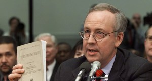 Independent Counsel Kenneth Starr holds a copy of his report while testifying Nov. 19, 1998, before the House Judiciary Committee's hearing on the impeachment of President Bill Clinton. Appointed by a special committee of federal judges, and essentially impossible to fire, Starr took the widest possible view of what he should investigate. (AP file photo)