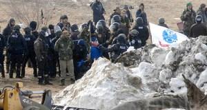 Law enforcement officers arrest Dakota Access oil pipeline protesters on Feb. 23, 2017, in Morton County, North Dakota. (AP photo: The Bismarck Tribune)