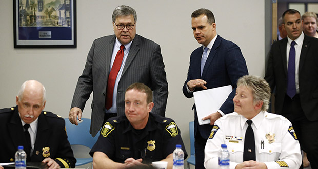 Attorney General William Barr, center, arrives Nov. 21 at a roundtable with members of local, state and federal law enforcement agencies at the Cleveland Police Department's Third District station. Following Barr is Justin Herdman, U.S. attorney for the Northern District of Ohio. (AP photo)