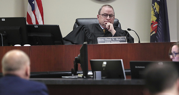 Ozaukee County Circuit Judge Paul Malloy listens to attorneys from both sides Monday, Jan. 13, 2020 before making his finding at the Ozaukee County Courthouse in Port Washington, Wis., where Judge Malloy held state election officials in contempt of court for not following his order to remove thousands of people from the voters rolls. (Milwaukee Journal-Sentinel via AP)