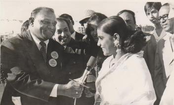 Mr. Amichand Rajbansi interviewing Hemlata at milk carnival