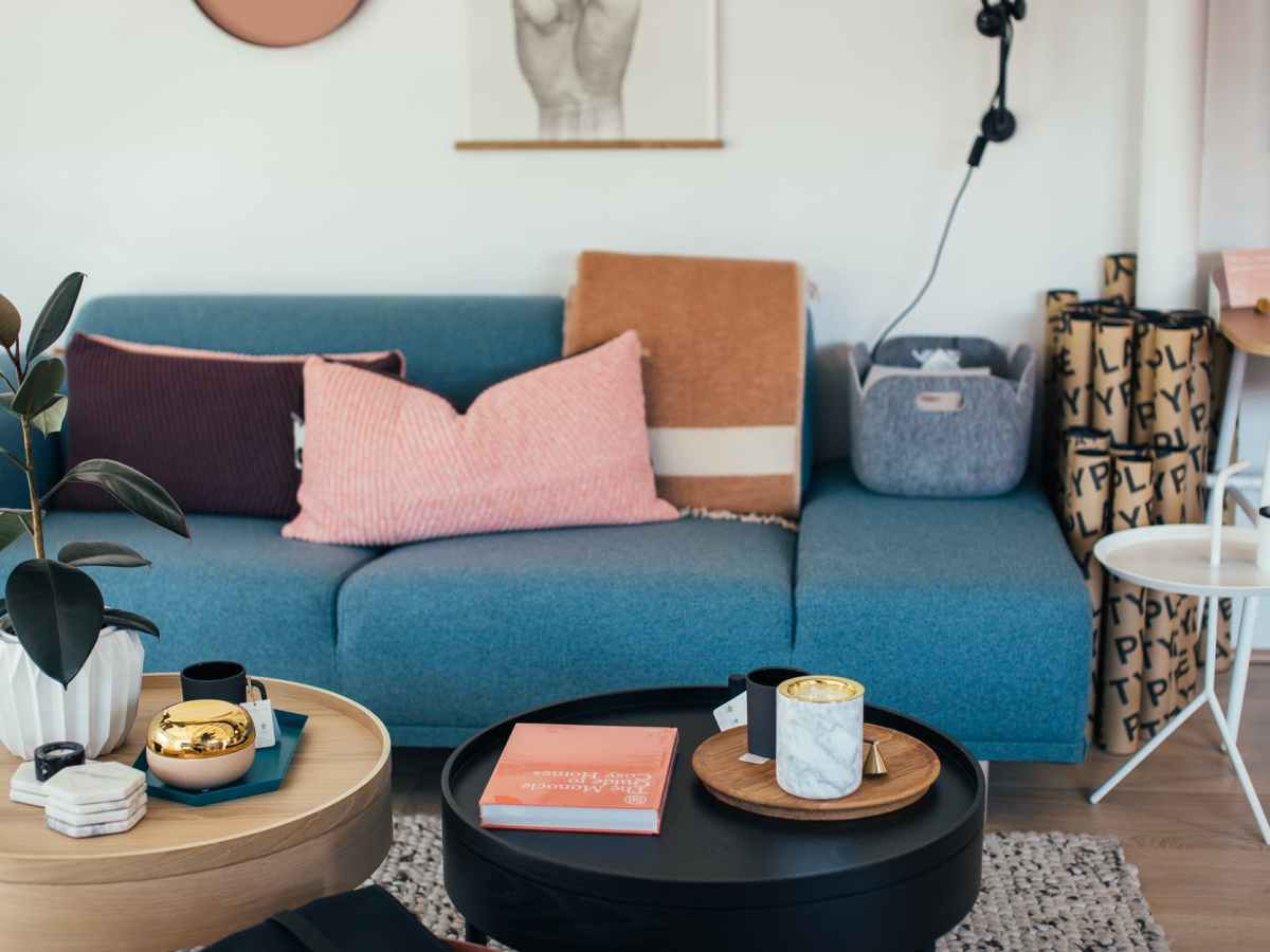 interior of living room with cozy couch and round coffee tables