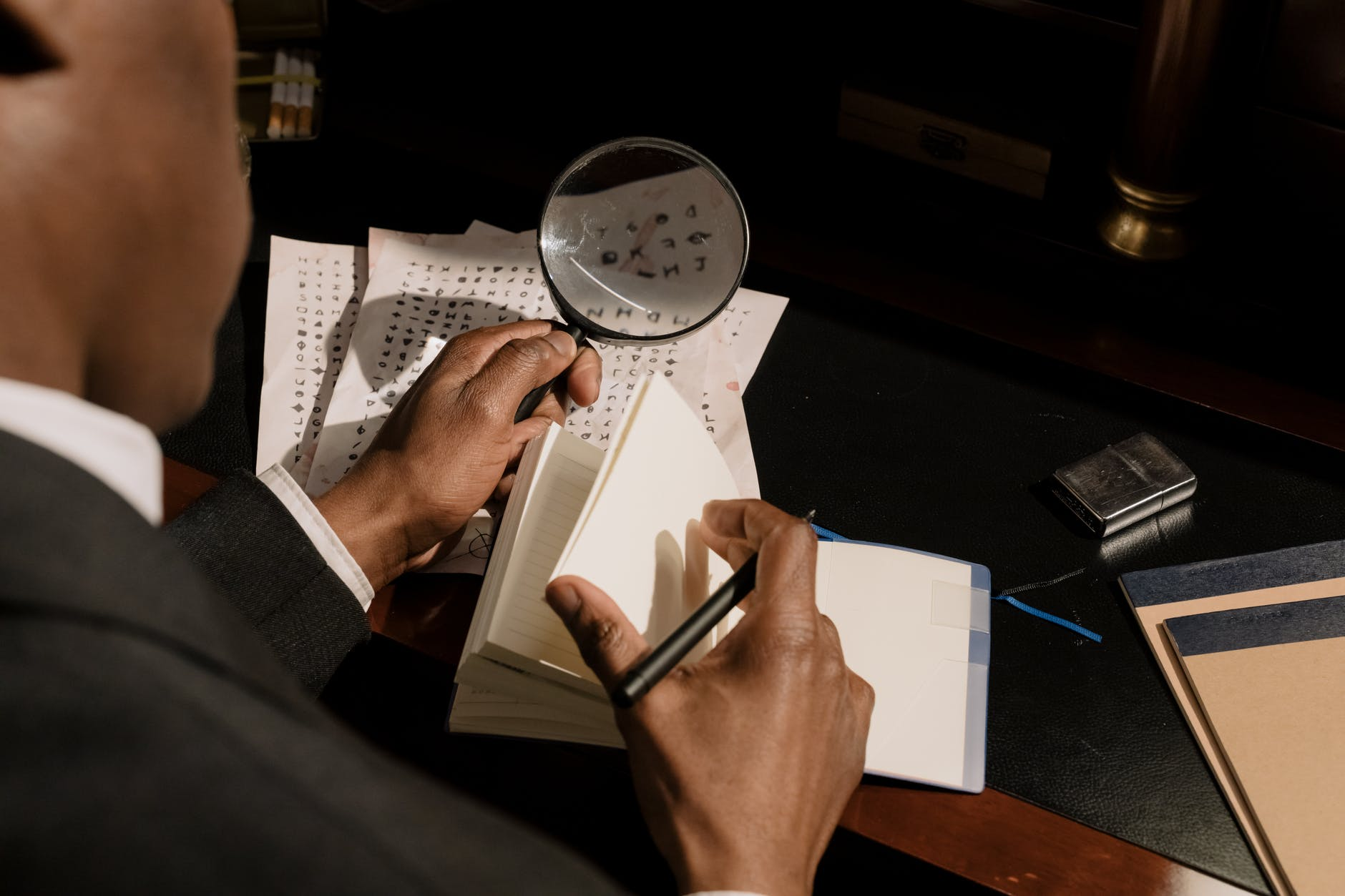 photo of detective decoding characters