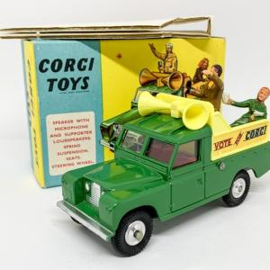 "Corgi 472 Land Rover Public Address Vehicle ""Vote for Corgi"" - green, yellow plastic back and speakers, red interior, silver trim, 2 x figures, spun hubs - Near Mint lovely bright example in a a very crisp box that would be near mint apart from the cellotape marks. Also comes with correct inner packing piece and collectors club folded leaflet."