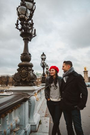 Travel couple on Pont Alexandre III in Paris, France