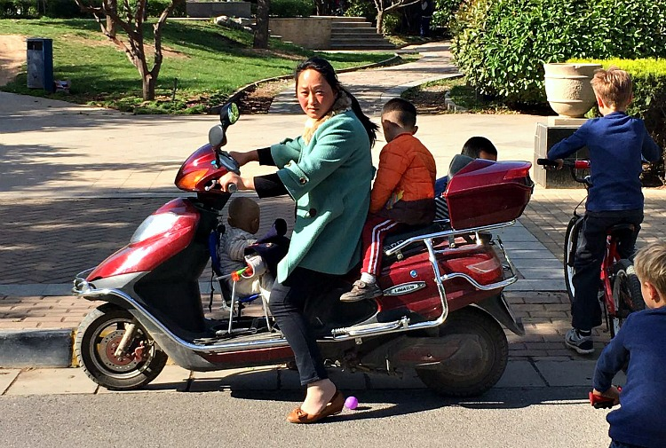 China: Babes on bikes....notice anything unusual. #XianScenes #ThisisChina Photo courtesy of Steve Kotso