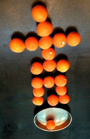 China: Celebrating CNY with lucky oranges in the shape of the chinese character for 'good luck'....