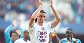 Andy Carroll applauds the West Ham fans