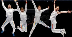 epa04791019 (L-R) Simona Pop, Loredana Dinu, Simona Gherman and Ana Maria Branza from Romania jump in the air after beating Estonia at the women's team epee final at the European Fencing Championships in Montreux, Switzerland, 09 June 2015. EPA/VALENTIN FLAURAUD