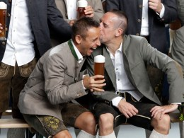 Bayern's Rafinha, left, and Franck Ribery wearing traditional Bavarian clothes share a joke during a photo-shooting of a beer brewing company in Munich, Germany, Wednesday, Sept. 14, 2016. (AP Photo/Matthias Schrader)