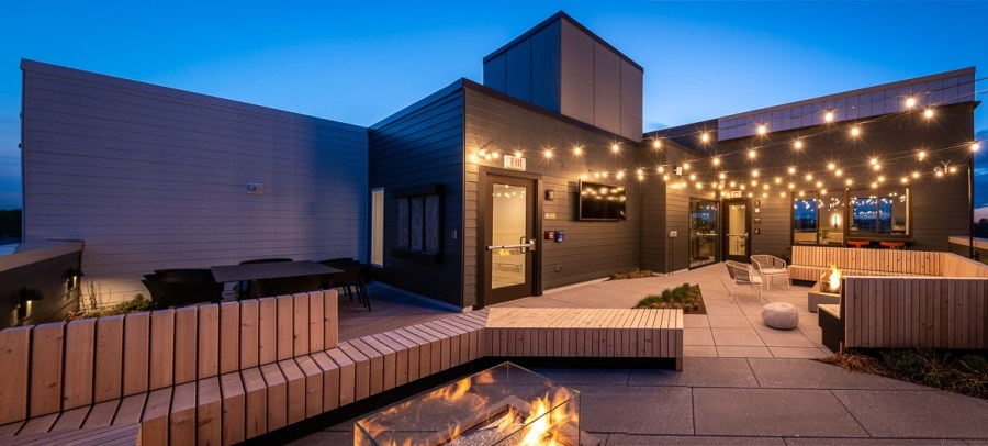 rooftop lounge with firepits tv and a great view