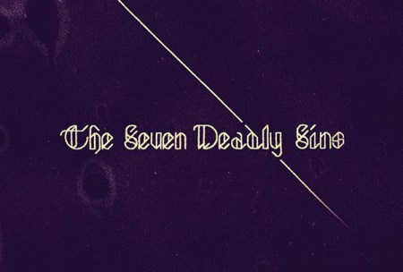 the seven deadly sins typed on black background
