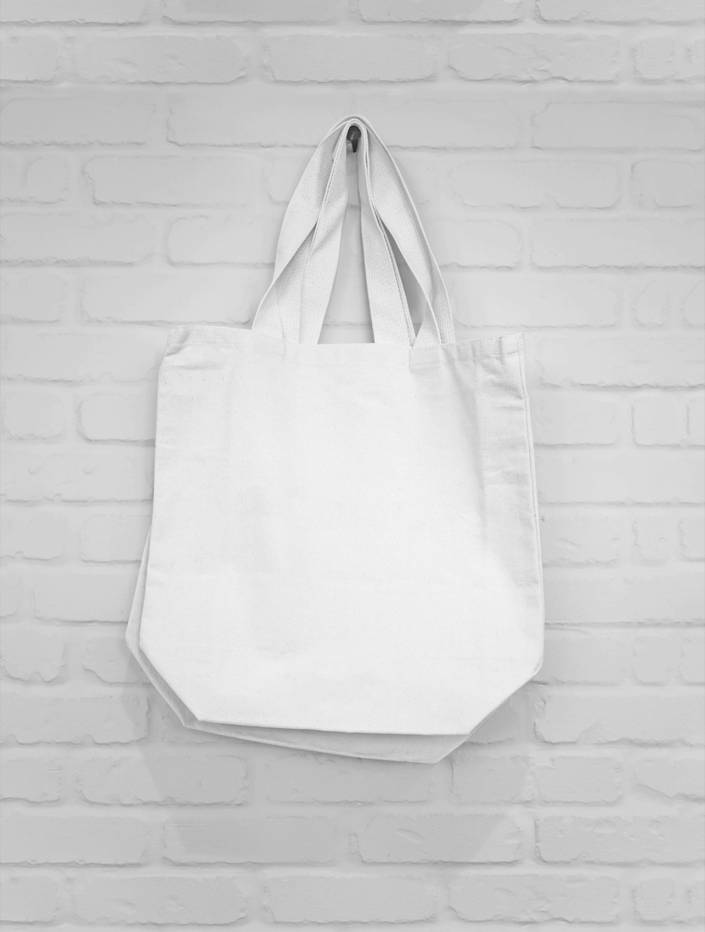 The design is also simple with hand and you can add other ornaments to make it more interesting. Free Hanging Canvas Bag Mockup On Behance