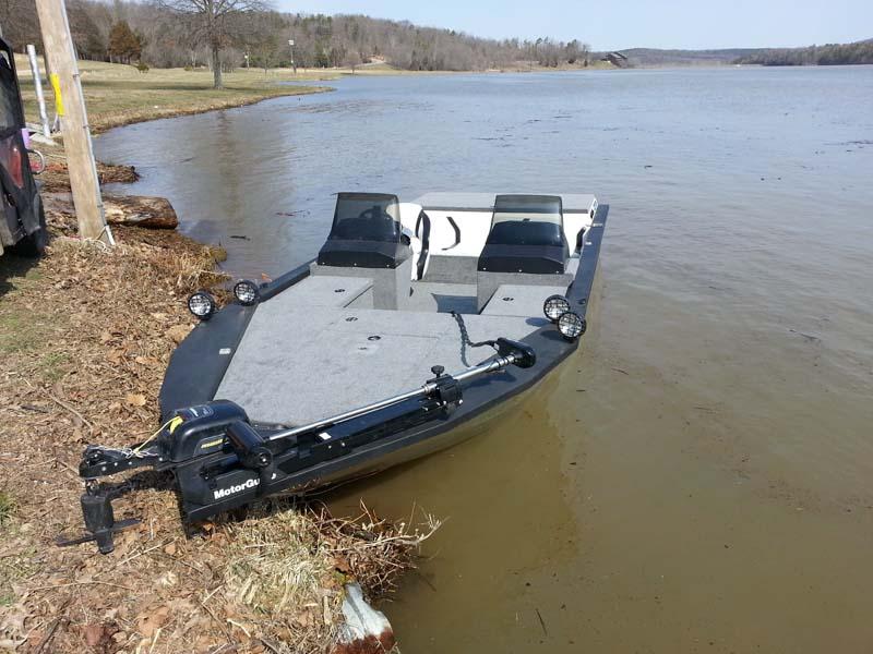 black boat docked on a lake