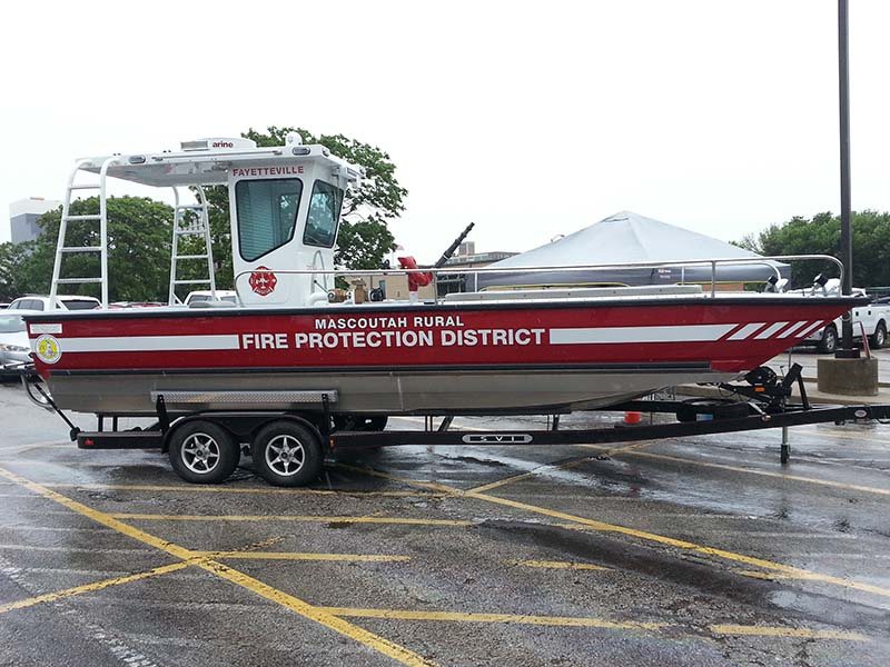 fire protection district boat on a trailer in a parking lot