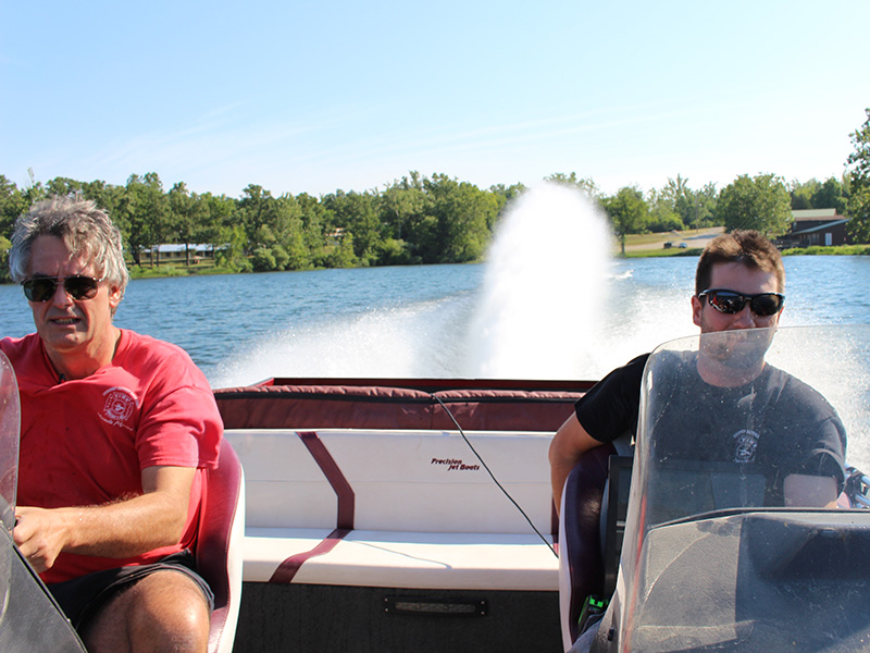 two men driving a boat