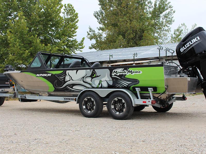 green boat on trailer