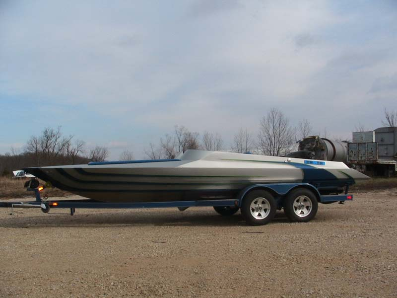 blue and gray boat side view