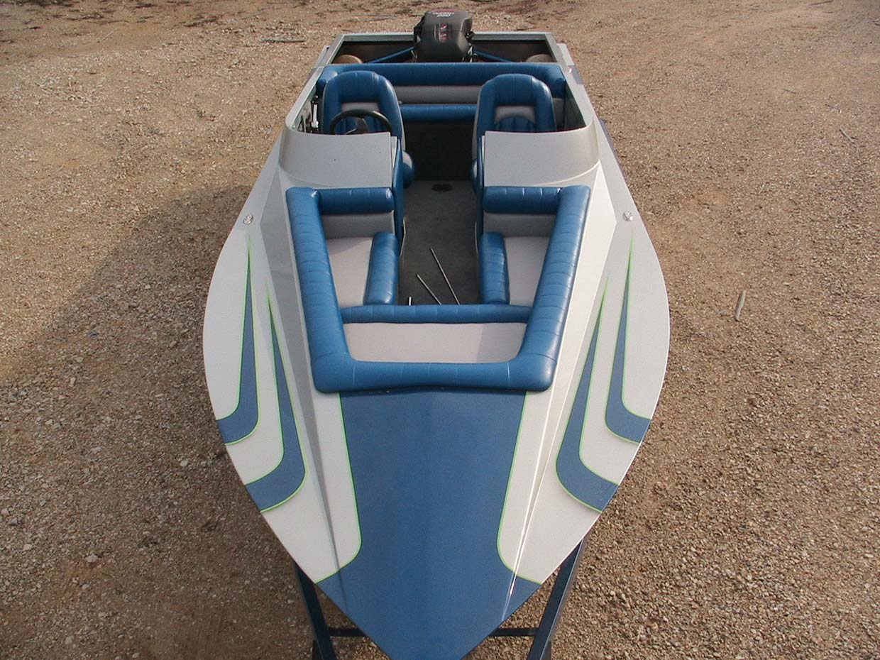 blue and white boat overhead view