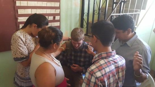 Church members praying for Gerrett.