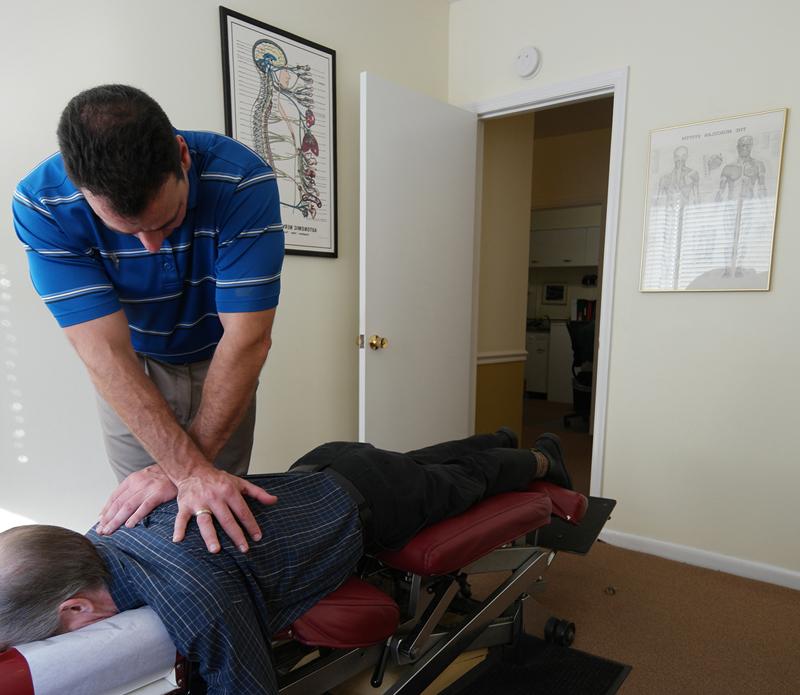 Dr Mirando performing chiropractic adjustment services