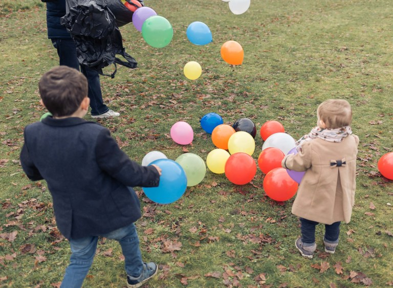 Family outdoor fun with the balloons in the local Enfield park.