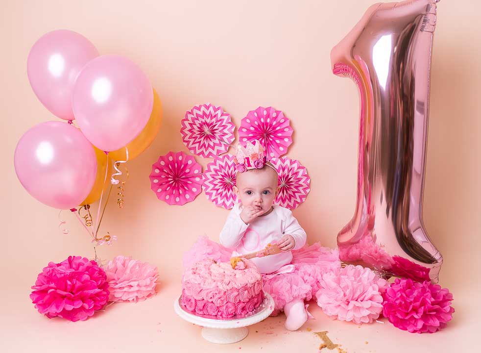Cake smash 1st Birthday Photos - balloons and baby girl and decorations, the whole set up