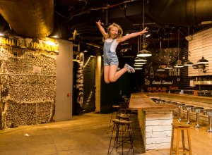 dancing gymnastics jumping off the table Camden market of Camden Town London family photographer