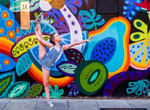 Gymnastics in front of graffitis Camden town Family Photographer London Enfield