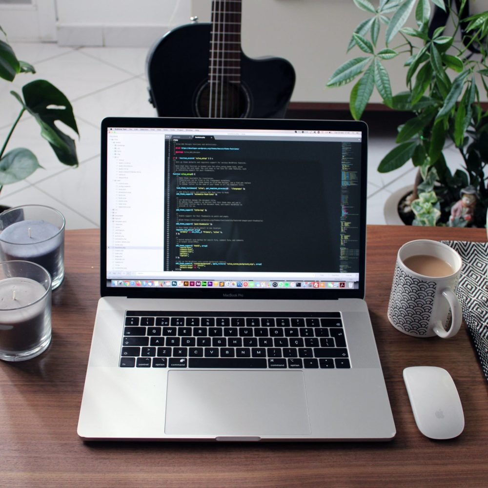 MacBook Pro Desktop Scene with Plants & Guitar by Nathan da Silva