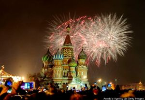 MOSCOW, RUSSIA - JANUARY 01: Fireworks light up the sky above the Saint Basil's Cathedral during the welcoming ceremony for the new year at the Red Square in Moscow, Russia on January 1, 2015. (Photo by Sefa Karacan/Anadolu Agency/Getty Images)