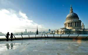A couple admire the view of St Pauls Cathedral from the rooftop terrace of the One New Change building on November 16, 2010 in London, England.