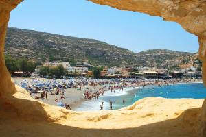 beach-view-from-the-inside-of-the-caves-of-matala-in-phaistos