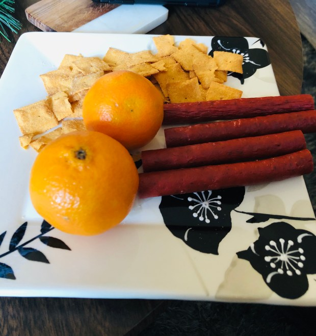 Cauliflower crisps, oranges, and turkey snacks for lunch