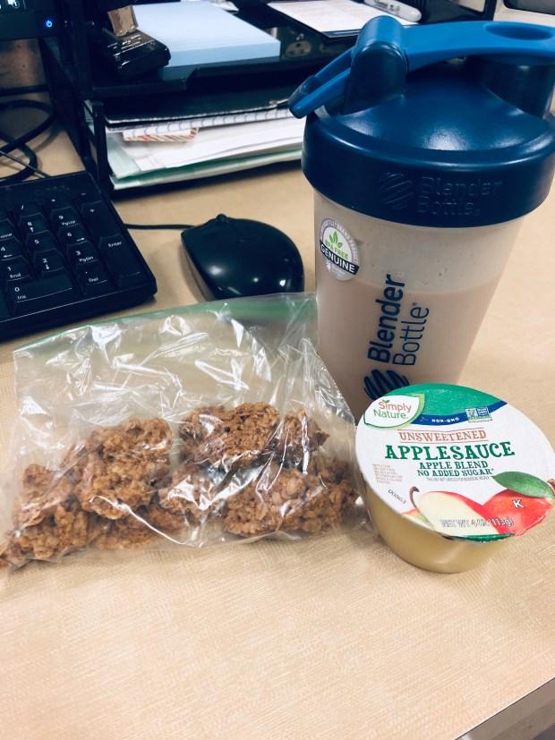 Granola, protein shake, and applesauce