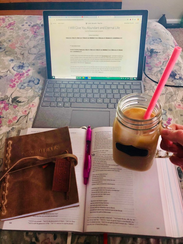 Devotional, journal, bible. and iced coffee