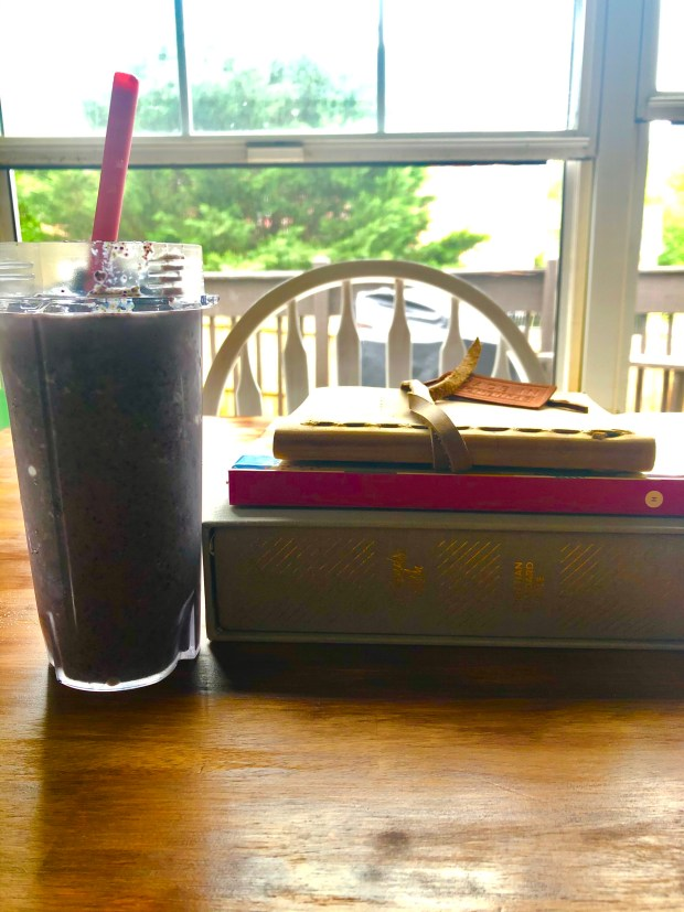 Breakfast smoothie and books