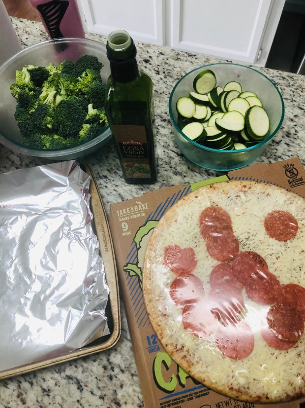 Cooking pizza and veggies