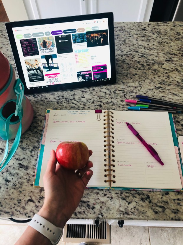 Weekly planner and apple