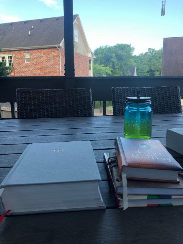 Bible, devotional, and journals on back deck