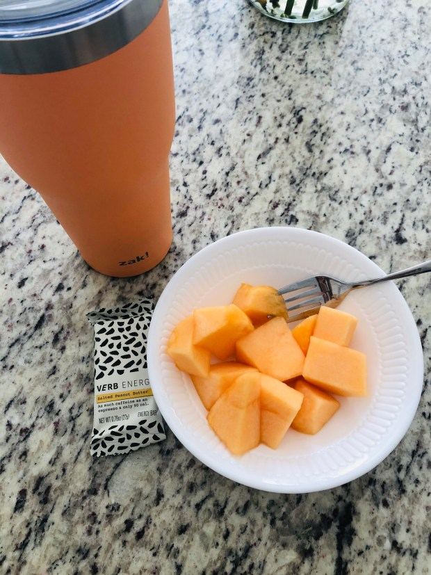 Water, cantaloupe, and energy bar