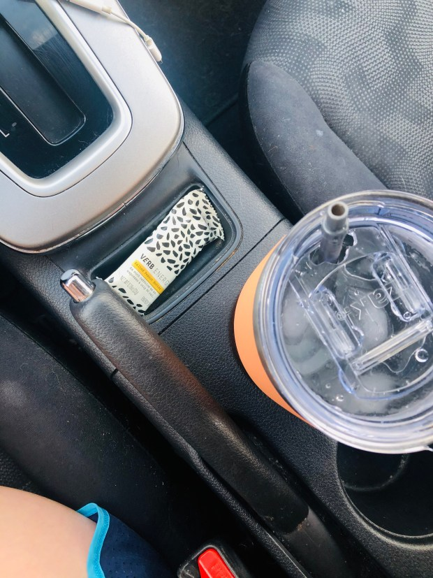 Verb bar and water bottle in car