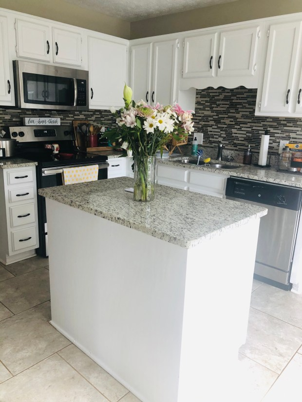 Clean kitchen with flowers