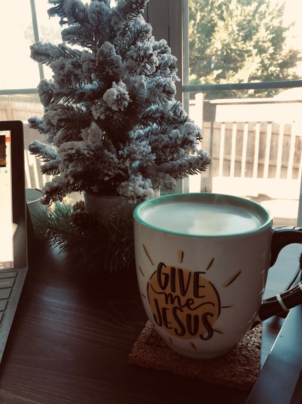 Cup of coffee and Christmas tree
