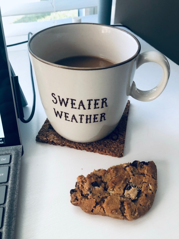 Cup of coffee and half a cookie